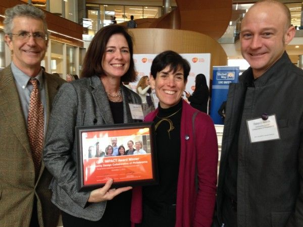 Board members Paul Sehnert, Alice Berman, and Daryn Edwards join Beth Miller at the GSK IMPACT Award ceremony.