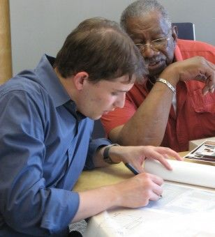 A Collaborative volunteer works with a client to develop improvement plans.